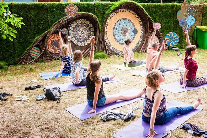 IMAGE: Photo – Down the Rabbit Hole festival – fence and yoga