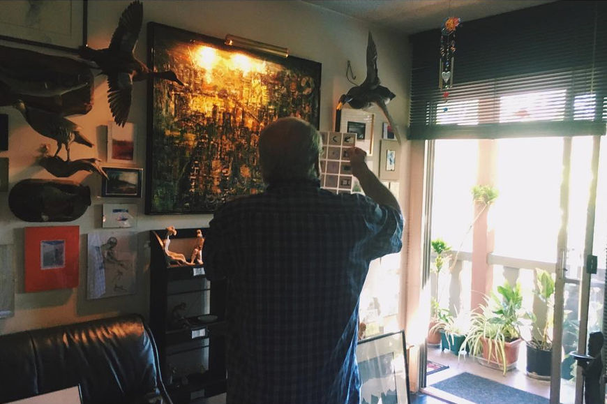 IMAGE: Photo - Sandy in his studio looking at slides