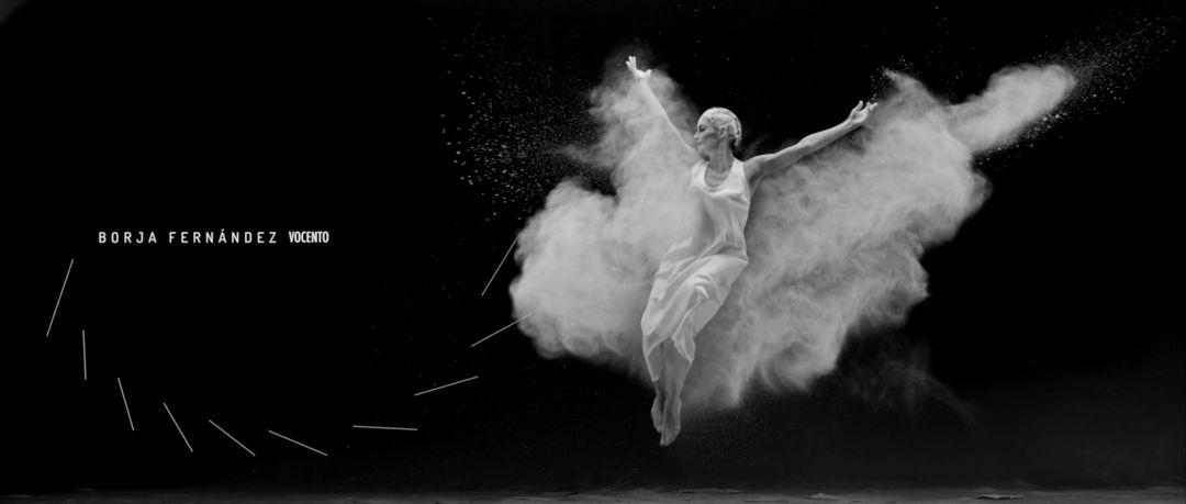 IMAGE: Still –female dancer throwing flour