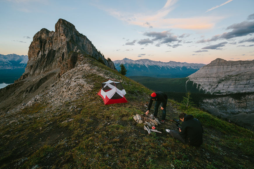 IMAGE: Photograph – tent and campfire setup