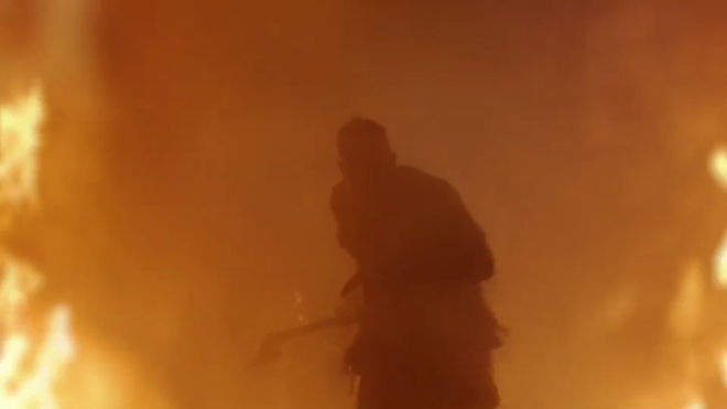 IMAGE: Still - figure walking through fire from season 4 sequence