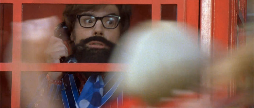 IMAGE: Still of Austin Powers hiding in a phone booth